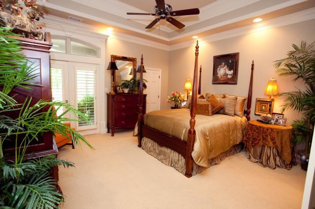 Traditional Bedroom with gold custom bed linens