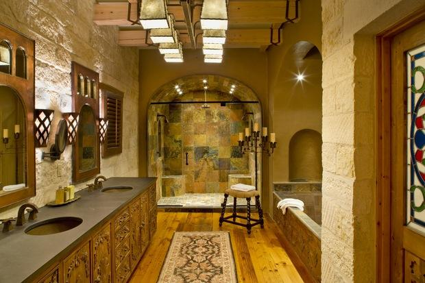 Rustic Bathroom with intricately carved wooden cabinets