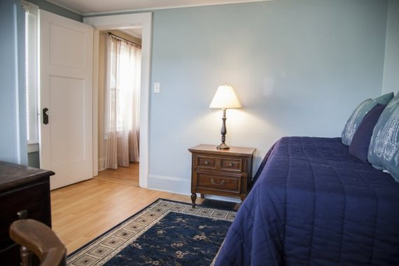 a blue-walled bedroom