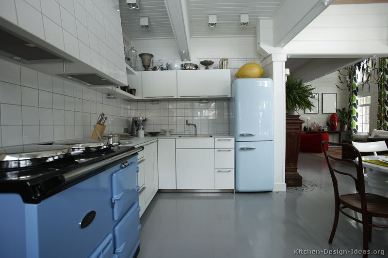 A blue retro-style refrigerator and AGA stove add a classic feel to this kitchen