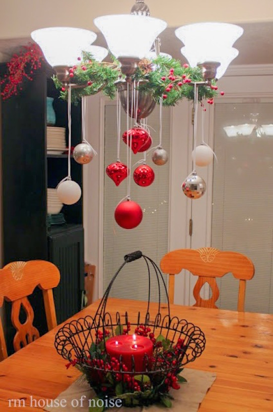 It's beginning to look a lot like Christmas! This is a really cute way to use Christmas decorations above the table instead of on the table.