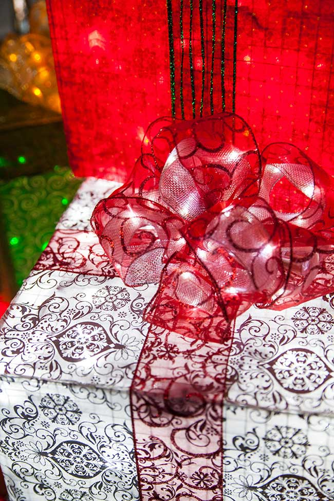 Illuminate a plain ribbon bow by lining it with fairy lights or ribbon lights!