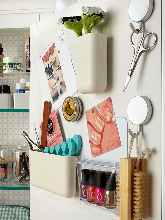DIY Bathroom Organization Ideas - Mount a magnetic memo board inside a cabinet door to add more storage with magnetic containers via BHG #bathroomorganization #bathroomideas #bathroomhacks #bathroomtips #organizethebathroom