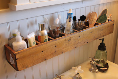 DIY Bathroom Organizer Ideas - Turn a divided box or CD Tower on its side and mount it on the wall as the greatest space saving organizer for your bathroom via Itsy Bits and #bathroomorganization #bathroomideas #bathroomhacks #bathroomtips #organizethebathroom