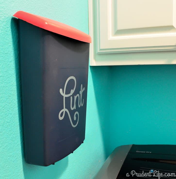 This is a great idea - make a wall mounted lint bin next to the dryer!