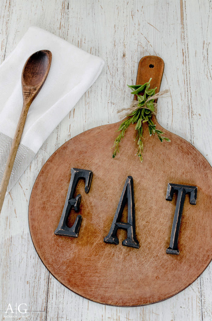 Learn how to make this rustic kitchen decor for your home using a repurposed cutting board.   www.andersonandgrant.com