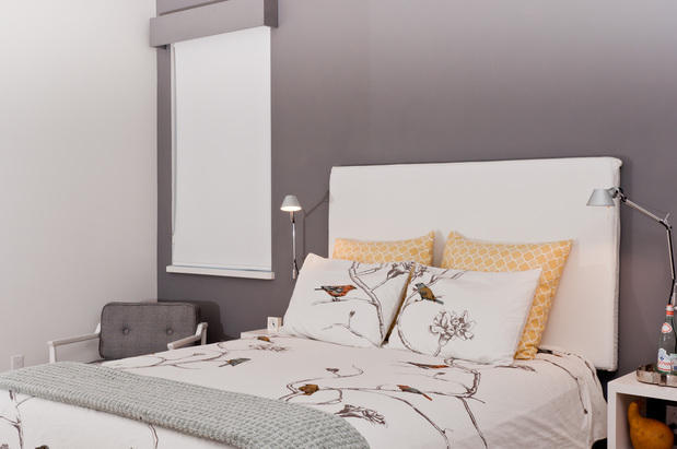 Modern Bedroom with white upholstered head board