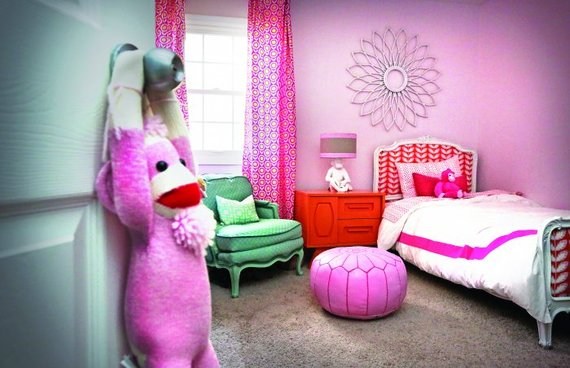 kids bedroom pink wall with a sock monkey