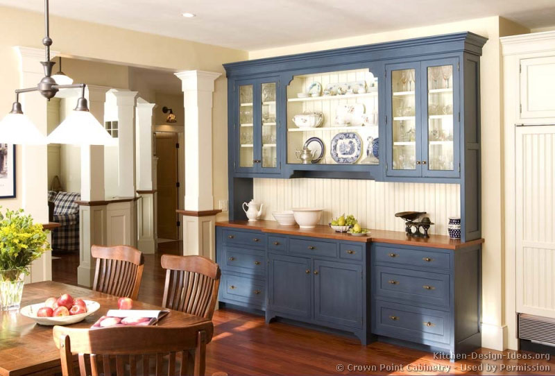 Painting old cabinets and adding glass panels can be an inexpensive way to revamp the look of your entire kitchen.