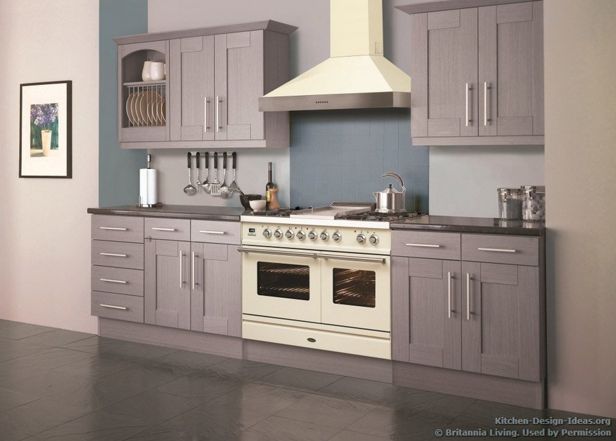 A soft lavender kitchen with a cream-colored range oven and hood