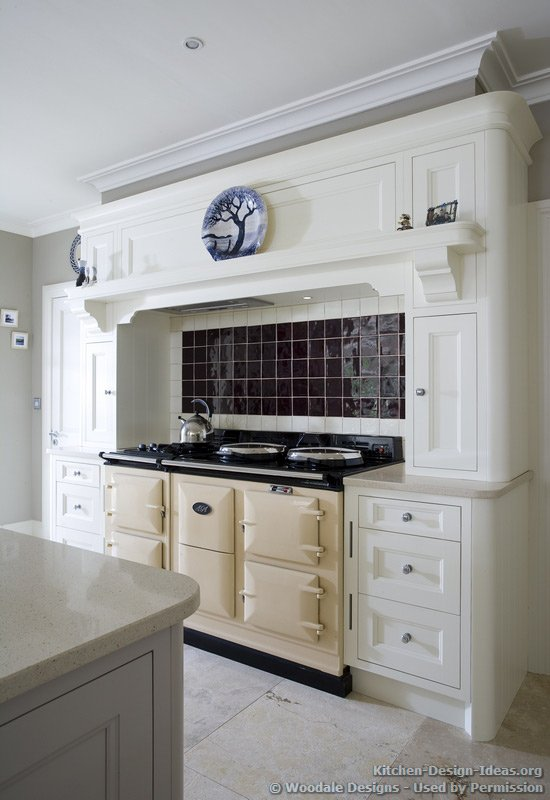 This cream-colored AGA range adds class to this vintage white kitchen