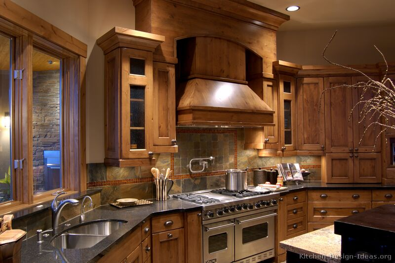 Rustic Kitchen Design with Pro Viking Range, Large Wood Hood, and Slate Tile Backsplash