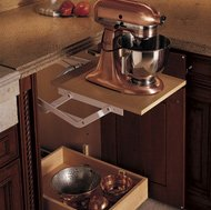 An appliance lift rises from a base cabinet and locks into place while you work.