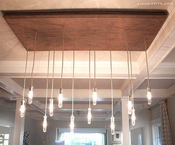 DIY Industrial Edison Style Chandelier: This awesome chandelier is made from a recycled coffee table or cabinet door. It add a rustic warm to your home.
