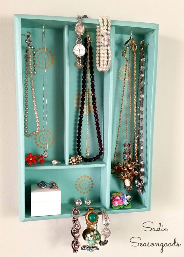 DIY Bathroom Organizer Ideas - Upcycle a silverware tray into a pretty hanging jewelry organizer - Tutorial via Sadie Seasongoods #bathroomorganization #bathroomideas #bathroomhacks #bathroomtips #organizethebathroom