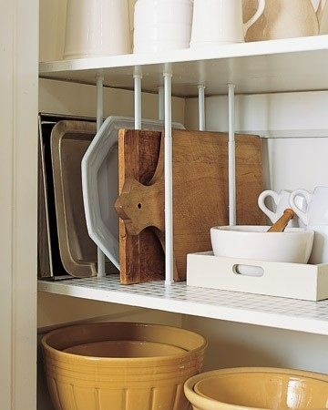 12-Easy-Kitchen-Organization-Tips-Use-tension-rods-as-dividers-for-upright-storage-2