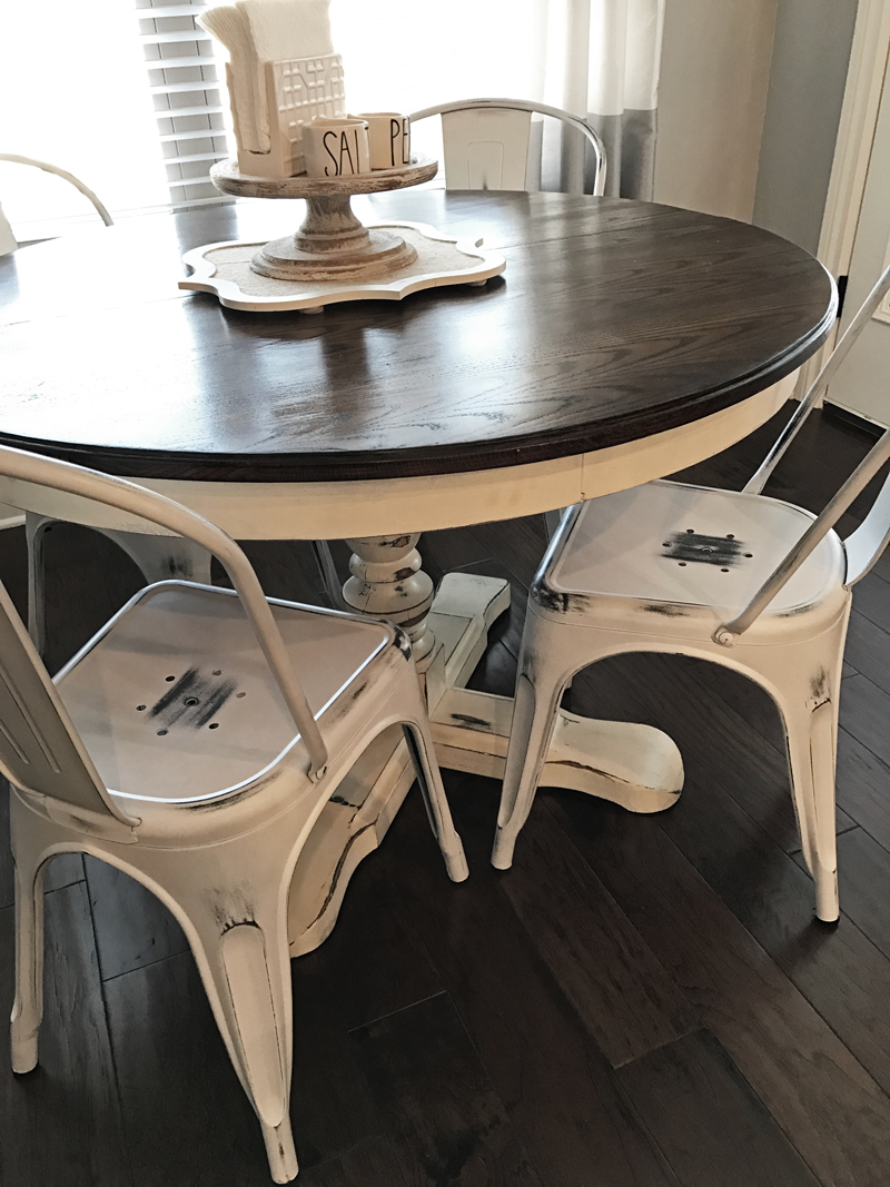 The perfect farmhouse dining room decor with metal white wash chairs
