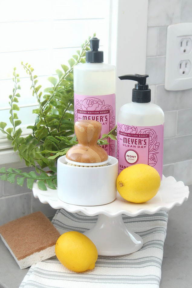 Spring cleaning supplies and spring cleaning tips. This is a pretty way to display dish soap and hand soap.